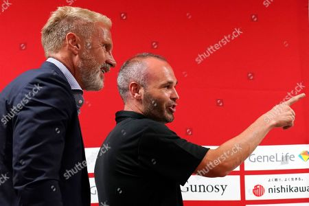 Andres Iniesta, Thorsten Fink. Vissel Kobe's Andres Iniesta, right, and his team's head coach Thorsten Fink speak after their pre-match press conference at Noevir Stadium in Kobe, western Japan . FC Barcelona and Japan's Vissel Kobe will meet at a friendly soccer match on July 27