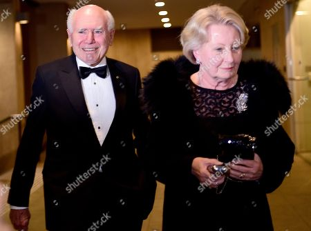 Australian former prime minister John Howard (L) and wife Janette Howard arrive for his birthday function at The Australian Club, in Sydney, New South Wales, Australia, 26 Jul 2019. Former prime minister John Howard is celebrating his 80th birthday.