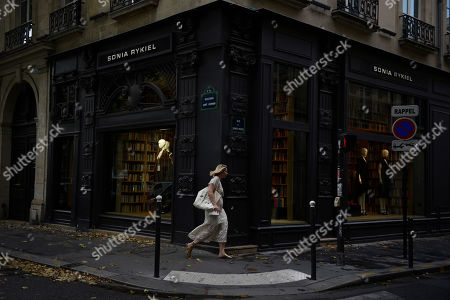 A pedestrian walks past the Sonia Rykiel shop windows on the Boulevard Saint Germain in Paris, France, 26 July 2019. According to reports on 25 July 2019 French Sonia Rykiel fashion house is going into liquidation following a court decision.