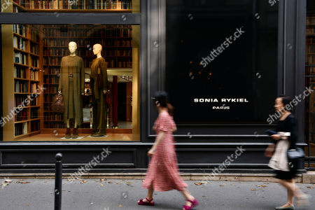 Stock Picture of Pedestrian walk past the Sonia Rykiel shop on the Boulevard Saint Germain in Paris, France, 26 July 2019. According to reports on 25 July 2019 French Sonia Rykiel fashion house is going into liquidation following a court decision.