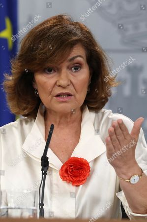 Stock Photo of Acting Spanish Deputy Prime Minister Carmen Calvo Poyato addresses a press conference after the weekly Cabinet meeting at La Moncloa Palace in Madrid, Spain, 26 July 2019. Calvo said that the Government 'does not throw in the towel' and 'maintains the enthusiasm and commitment' despite the unsuccessful investiture vote of acting Prime Minister Pedro Sanchez (unseen), held a day before. Calvo blamed Spanish People's Party and Ciudadanos (Citizens) party of the failure of the investiture process.