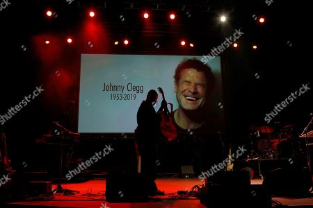 An artist prepares the stage prior to the memorial for South African musician Johnny Clegg in Johannesburg, South Africa, 26 July 2019. Clegg died of cancer at the age of 66 after a career with his band Juluka.