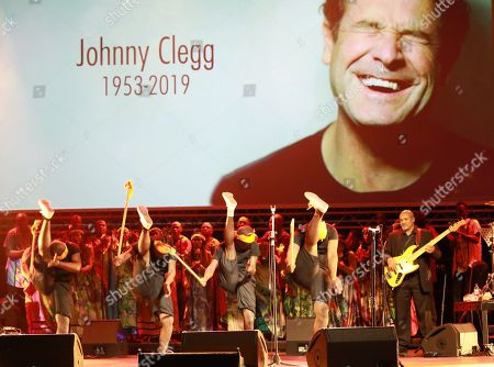 Stock Image of Performers sing and dance during the memorial for late South African musician Johnny Clegg in Johannesburg, South Africa, 26 July 2019. Clegg died of cancer at the age of 66 after a career with his band Juluka.