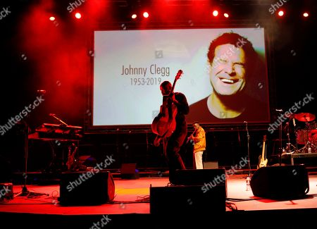 Stock Picture of An artist prepares the stage prior to the memorial for South African musician Johnny Clegg in Johannesburg, South Africa, 26 July 2019. Clegg died of cancer at the age of 66 after a career with his band Juluka.