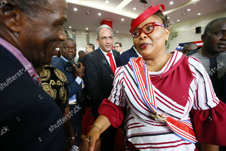 Leymah Gbowee (C), 2011 Nobel Peace Prize Laureate and National Orator of the event shake hands with guests during the official ceremony marking Liberia's 172nd Independent Anniversary at the Samuel Kanyon Doe Sports Stadium in Paynesville outside Monrovia, Liberia, 26 July 2019. The Presidents of Nigeria, Sierra Leone, Guinea, Ivory Coast, Burkina Faso are in attendance to grace this year's occasion.  Liberia declared its independence in 26 July 1847, making the West African nation the first democratic republic in the history of Africa.