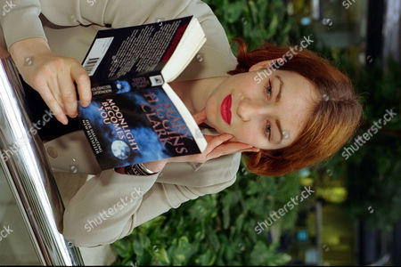 Harriett Margolis Reading Paperback Book By Mary Higgins Clark For Feature.