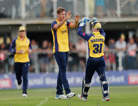 Matt Quinn (L) of Essex is congratulated by Adam Wheater after he bowled Zak Crawley during Kent Spitfires vs Essex Eagles, Vitality Blast T20 Cricket at The Spitfire Ground on 26th July 2019