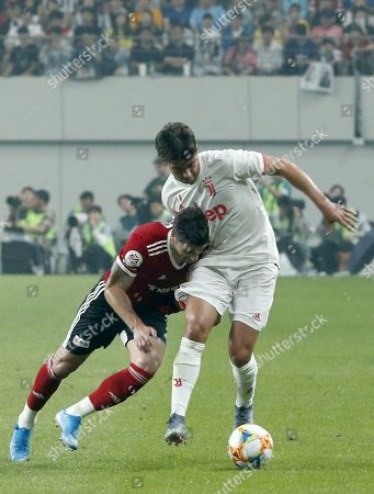 Juventus' Pietro Peruatto (R) in action against Team K League players Eder Luiz Lima de Souza (L) during the friendly soccer match between Team K League and Juventus FC at the Seoul World Cup Stadium in Seoul, South Korea, 26 July 2019.