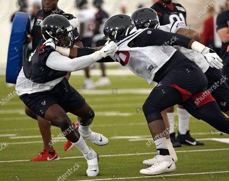 Joel Heath, Roderick Johnson. Houston Texans defensive end Joel Heathleft, grabs the jersey of offensive tackle Roderick Johnson during an NFL football training camp practice, in Houston