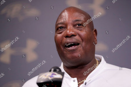 Former Baltimore Ravens general manager Ozzie Newsome speaks about fullback Vonta Leach speaks to reporters during a news conferencing announcing Leach is retiring from NFL football as a Raven, in Owings Mills, Md