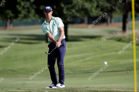 Billy Horschel chips onto the sixth green during the second round of the World Golf Championships-FedEx St. Jude Invitational, in Memphis, Tenn