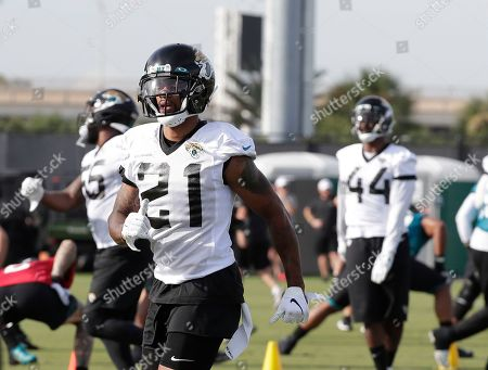 Jacksonville Jaguars cornerback A.J. Bouye (21) warms up with teammates during an NFL football practice at the teams training facility, in Jacksonville, Fla