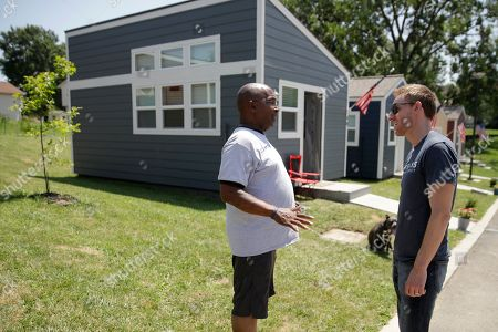 Jason Kander, right, talks to Army veteran Charlie Robinson as he tours the Veteran's Community Project with Missouri Republican Sen. Roy Blunt, in Kansas City, Mo. Kander, once considered a rising star in the Democratic party, ran against Blunt in 2016 before abruptly dropping out of politics to deal with post-traumatic stress disorder stemming from his Army tour in Afghanistan