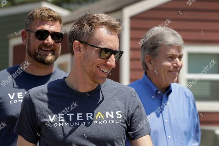 Jason Kander, center, tours the Veteran's Community Project with Missouri Republican Sen. Roy Blunt, right, in Kansas City, Mo. Kander, once considered a rising star in the Democratic party, ran against Blunt in 2016 before abruptly dropping out of politics to deal with post-traumatic stress disorder stemming from his Army tour in Afghanistan