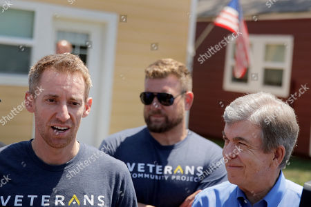 Jason Kander, left, talks to the media after touring the Veteran's Community Project with Missouri Republican Sen. Roy Blunt, right, in Kansas City, Mo. Kander, once considered a rising star in the Democratic party, ran against Blunt in 2016 before abruptly dropping out of politics to deal with post-traumatic stress disorder stemming from his Army tour in Afghanistan