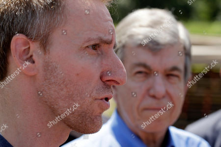 Jason Kander, left, talks to the media as Republican Sen. Roy Blunt looks on after a tour of the Veteran's Community Project, in Kansas City, Mo. Kander, once considered a rising star in the Democratic party, ran against Blunt in 2016 before abruptly dropping out of politics to deal with post-traumatic stress disorder stemming from his Army tour in Afghanistan