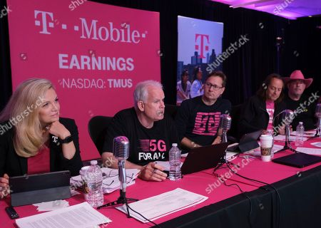T-Mobile Chief Technology Officer Neville Ray, second left, and executives including Executive Vice President of Communications and Community Engagement Janice Kapner President Mike Sievert, center, CEO John Legere, second from left, and CFO Braxton Carter answer a caller's questions during the T-Mobile Q2 2019 Earnings Call on in Bellevue, Wash. T-Mobile continues to set new records financially, while at the same time leading the industry in customer care and investing in its network to prepare for nationwide 5G with the aggressive rollout of its 600 MHz spectrum