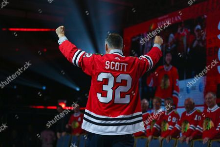 Former Chicago Blackhawks' John Scott is introduced to fans during the NHL hockey team's convention in Chicago