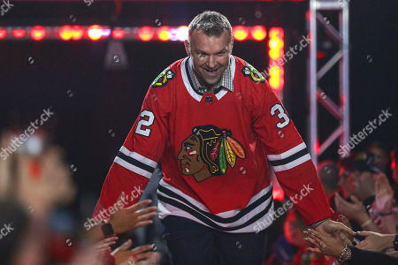 Stock Picture of Former Chicago Blackhawks player John Scott is introduced to fans during the NHL hockey team's convention in Chicago