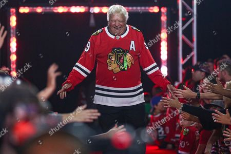 Former Chicago Blackhawks player Bobby Hull is introduced to fans during the NHL hockey team's convention in Chicago