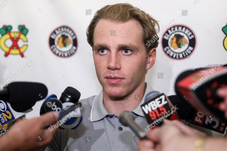 Chicago Blackhawks' Patrick Kane speaks to the media during the NHL hockey team's convention in Chicago