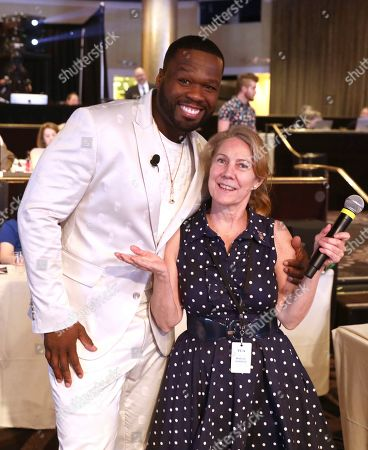 """Curtis Jackson, Margie Barron. Executive producer Curtis """"50 Cent"""" Jackson, left, poses with Margie Barron during the """"Power"""" panel at STARZ Summer 2019 TCA Panel at The Beverly Hilton Hotel, in Beverly Hills, Calif"""
