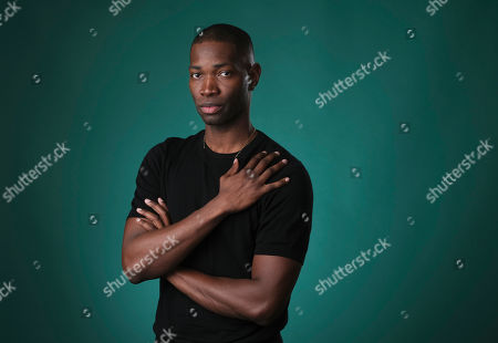 """Tarell Alvin McCraney, creator/executive producer of the OWN series """"David Makes Man,"""" poses for a portrait during the 2019 Television Critics Association Summer Press Tour at the Beverly Hilton, in Beverly Hills, Calif"""