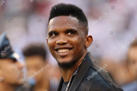 Soccer player Samuel Eto'o watches warmups before an International Champions Cup soccer match between Atletico Madrid and Real Madrid, in East Rutherford, N.J. Atletico Madrid won 7-3