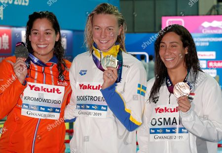 Gold medalist Sweden's Sarah Sjostrom, centre, stands with silver medalist Ranomi Kromowidjojo of the Netherlands, left, and bronze medalist Egypt's Farida Osman following the women's 50m butterfly final at the World Swimming Championships in Gwangju, South Korea