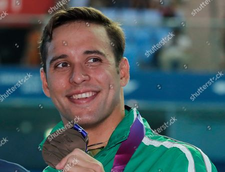 Bronze medalist South Africa's Chad le Clos poses with his medala following the men's 100m butterfly final at the World Swimming Championships in Gwangju, South Korea