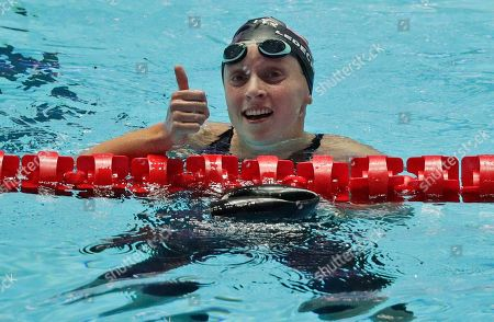 United States' Katie Ledecky reacts after winning the women's 800m freestyle final at the World Swimming Championships in Gwangju, South Korea