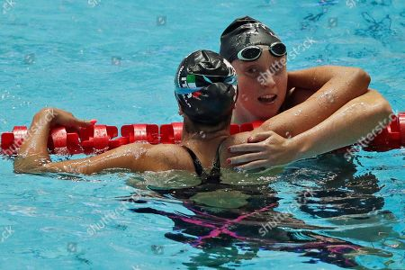 United States' Katie Ledecky, right, is congratulated by Italy's Simona Quadarella after winning the women's 800m freestyle final at the World Swimming Championships in Gwangju, South Korea