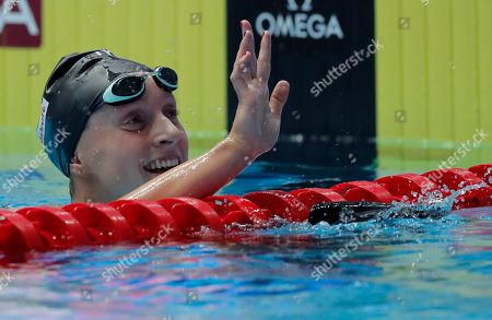 United States' Katie Ledecky waves after winning the women's 800m freestyle final at the World Swimming Championships in Gwangju, South Korea