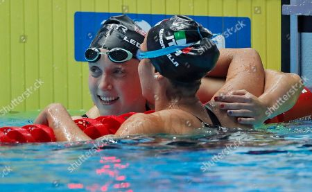 United States' Katie Ledecky is congratulated by Italy's Simona Quadarella, right, after winning the women's 800m freestyle final at the World Swimming Championships in Gwangju, South Korea
