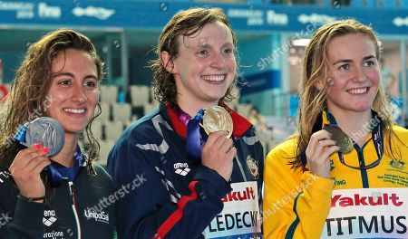 Gold medalist United States' Katie Ledecky, centre, stands with silver medalist Italy's Simona Quadarella, left, and bronze medalist Australia's Ariane Titmus following the women's 800m freestyle final at the World Swimming Championships in Gwangju, South Korea