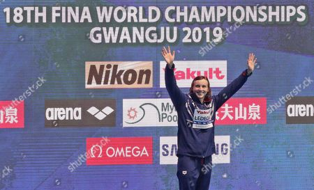 Gold medalist United States' Katie Ledecky waves on the podium following the women's 800m freestyle final at the World Swimming Championships in Gwangju, South Korea