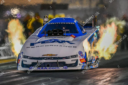 Stock Image of John Force struggles to keep all cylinders lit on this qualifying run during the NHRA Sonoma Nationals at Sonoma Raceway in Sonoma, California
