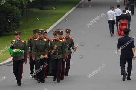 """Soldiers visit the Mansu Hill to pay respect to late leaders Kim Il Sung and Kim Jong Il on the occasion of the 66th anniversary of the end of the Korean War, which the country celebrates as the day of """"victory in the fatherland liberation war"""" in Pyongyang, North Korea"""