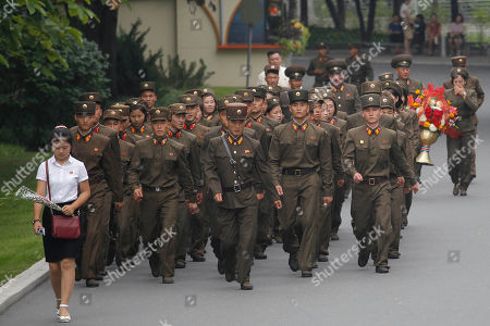"""Stock Photo of Soldiers visit the Mansu Hill to pay respect to late leaders Kim Il Sung and Kim Jong Il on the occasion of the 66th anniversary of the end of the Korean War, which the country celebrates as the day of """"victory in the fatherland liberation war"""" in Pyongyang, North Korea"""