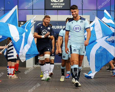 Ryan Wilson and Adam Hastings, right, run out at Murrayfield Stadium wearing the new home and away strip for the Autumn Internationals.