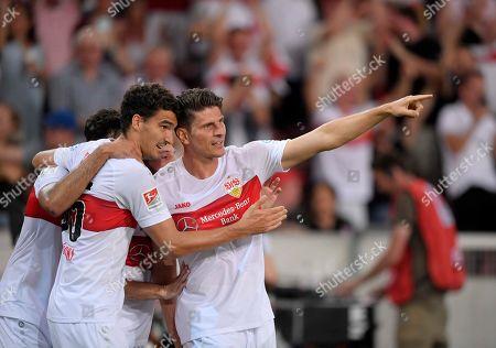 26.07.2019, Football 2.Bundesliga 2019/2020, 1. match day, VfB Stuttgart - Hannover 96, in Mercedes-Benz-Arena Stuttgart, re:  Mario Gomez ( Stuttgart) and Marcin Kaminski (Stuttgart).