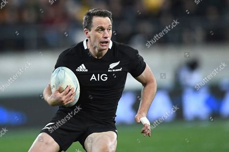 New Zealand's Ben Smith carries the ball against South Africa during a Rugby Championship match between the All Blacks and South Africa in Wellington, New Zealand