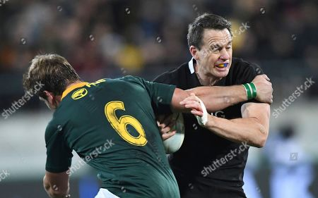 New Zealand's Ben Smith, right, is held by South Africa's Kwagga Smith during a Rugby Championship match between the All Blacks and South Africa in Wellington, New Zealand