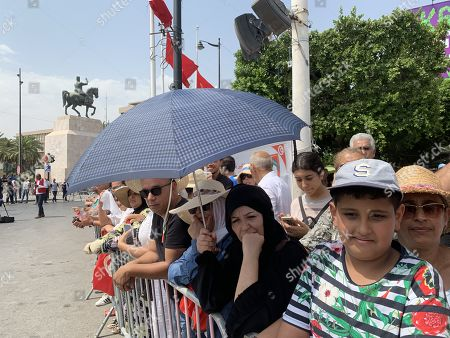 Tunisians gather in the Avenue Mohamed V where the convoy of the gasket of late President Beji Caid Essebsi is due to pass by heading towards the cemetery in Tunis, Tunisia, 27 July 2019. President of Tunisia Beji Caid Essebsi died at age 92 on 25 July 2019. Several heads of states or representatives are expected to gather at the Presidential Palace on 27 July to pay their respects before his burial later the same day.