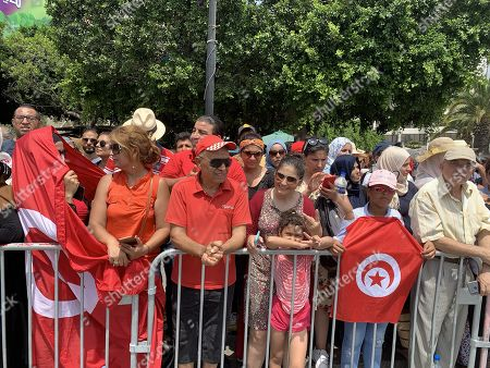 Tunisians gather in the Avenue Mohamed V where the convoy of the coffin of late President Beji Caid Essebsi is due to pass by heading towards the cemetery in Tunis, Tunisia, 27 July 2019. President of Tunisia Beji Caid Essebsi died at age 92 on 25 July 2019. Several heads of states or representatives are expected to gather at the Presidential Palace on 27 July to pay their respects before his burial later the same day.
