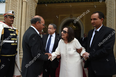 Former Tunisian president Moncef Marzouki (C-L) consoles former first lady Chadlia Saïda Farhat, widow of late Tunisian president Beji Caid Essebsi (C), during Essebsi's state funeral at the presidential palace in the eastern suburb of Carthage, Tunis, Tunisia, 27 July 2019. Essebsi, the country's first head of state elected in nationwide polls, died on 25 July at the age of 92, triggering fears of political unrest in a country seen as a rare success story following the Arab Spring uprisings.