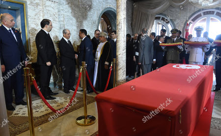 Tunisian Prime Minister Youssef Chahed (2-L) and interim president Mohamed Ennaceur (3-L) receive condolences from state guests during the state funeral of late president Beji Caid Essebsi at the presidential palace in the eastern suburb of Carthage, Tunis, Tunisia, 27 July 2019. Essebsi, the country's first head of state elected in nationwide polls, died on 25 July at the age of 92, triggering fears of political unrest in a country seen as a rare success story following the Arab Spring uprisings.