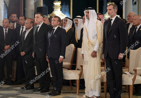 (R-L) Arab League Secretary-General Ahmed Aboul Gheit, King Felipe VI of Spain, Qatar's Emir Sheikh Tamim bin Hamad al-Thani, French President Emmanuel Macron, Libya's UN-recognised Prime Minister Fayez al-Sarraj, and Former Tunisian president Moncef Marzouki attend the state funeral of late president Essebsi at the presidential palace in the eastern suburb of Carthage, Tunis, Tunisia, 27 July 2019. Essebsi, the country's first head of state elected in nationwide polls, died on 25 July at the age of 92, triggering fears of political unrest in a country seen as a rare success story following the Arab Spring uprisings.