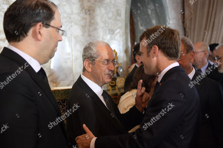 French President Emmanuel Macron (R) speaks with interim Tunisian president Mohamed Ennaceur (2-L) as Prime Minister Youssef Chahed (L) stands by during the state funeral of late Tunisian president Beji Caid Essebsi at the presidential palace in the eastern suburb of Carthage, Tunis, Tunisia, 27 July 2019. Essebsi, the country's first head of state elected in nationwide polls, died on 25 July at the age of 92, triggering fears of political unrest in a country seen as a rare success story following the Arab Spring uprisings.