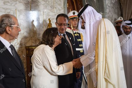 Qatar's Emir Sheikh Tamim bin Hamad al-Thani (C-R) consoles the widow of late Tunisian president Beji Caid Essebsi, former first lady Chadlia Saïda Farhat (C-L) in the presence of her son Hafedh Caid Essebsi and interim president Mohamed Ennaceur (L), during Essebsi's state funeral at the presidential palace in the eastern suburb of Carthage, Tunis, Tunisia, 27 July 2019. Essebsi, the country's first head of state elected in nationwide polls, died on 25 July at the age of 92, triggering fears of political unrest in a country seen as a rare success story following the Arab Spring uprisings.